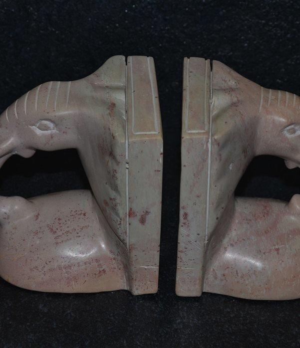 Fermalibro faccia elefante pietra